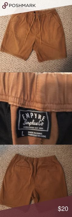 Empyre Khaki Shorts Empyre khaki shorts with elastic waist and draw strings. Shorter style, size large. In good condition! empyre Shorts