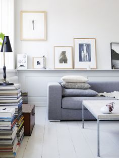 Not too keen on having stacks of books as living room decor, but perhaps I'll try it for the privacy of my own bedroom. However, I like the idea of having a wall ledge to show off artworks