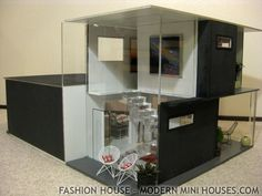 Modern Mansion Dollhouse | Here's a look at the stairs through the side window over the landing ...