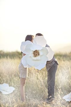 Engaged Photos featuring paper flowers