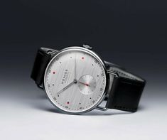 NOMOS Glasshütte exemplifies everything we love about watchmaking. Each minimal timepiece is handmade to exacting standards in Glasshütte, Germany. Understated aesthetics mean that NOMOS looks good at any time. Men's Watches, G Shock Watches Mens, High End Watches, Mens Sport Watches, Mens Watches Leather, Fashion Watches, Leather Men, Watches For Men, Luxury Watches