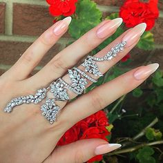 The ring is definitely too big, but the nails are gorgeous.