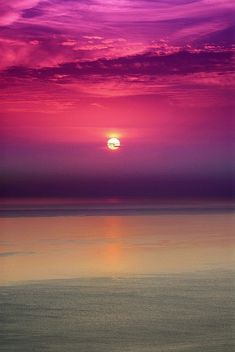 Evening Sun by Tony Armstrong, Beautiful in Purple of evening setting sun.