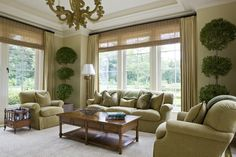 Satin drapes and bamboo roller shapes create textural visual appeal.