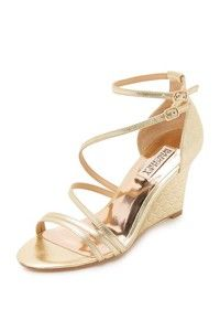 Delicate straps of metallic leather crisscross these eye-catching Badgley Mischka sandals. Scalloped detailing at the covered wedge heel. Slim buckle closures. Leather sole. Leather: Kidskin. Imported, China. This item cannot be gift-boxed. Measurements Heel: 3in / 75mm