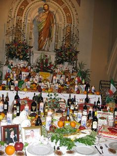 """19 March - St Joseph's Altar. The altars are Sicilian in origin and pay homage to Christ's """"earthly father,"""" Sicily's patron saint, who, the Sicilians believe, came to their aid with rain during a terrible famine. By way of thanks, the people of Sicily prepared a table with foods they had harvested as a result of the rain."""