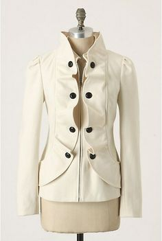 The buttons may serve no purpose at keeping the jacket together, but they certainly serve the purpose of fashion!