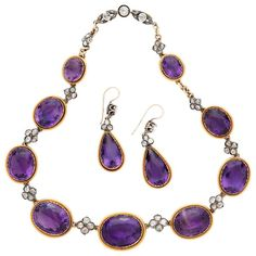 French Amethyst Necklace and Earring Set, circa 1893 -- Stamped with French hallmark and in extraordinarily good condition, this 18 karat yellow gold and silver set highlights approximately 73 carats of fine, vivid purple amethysts, surrounded by approximately 3 carats of Old European Cut Diamonds.