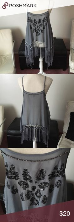 Final Price⚡️Forever 21 Sheer Top Today only. Flash sale. Price is firm and not included in bundle deals. Cute Forever 21 Sheer top with fringe on the bottom. Straps are adjustable. This has the sharkbite sides to it. In very good condition. Color is like a blueish gray with black Forever 21 Tops