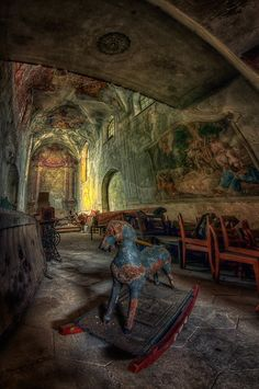 An amazing abandoned chapel in Poland. What is it about left behind children's belongings that make these broken places seem so much more intriguing.