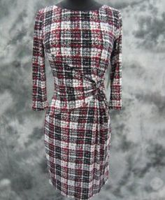 In LOVE with this checkered wrap dress!  It's long enough to keep you warm for the winter months and maintain a stylish presence.  Pair with some black tights and   suede black high heels for a sophisticated look.
