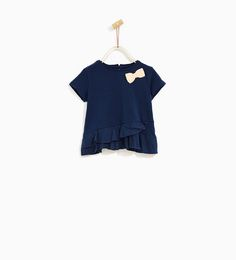 Image 1 of T-SHIRT WITH BOW AND FRILLS from Zara