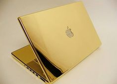 The most stylish Macbook ever! 24kt gold-plated Macbook Pro with diamond Apple logo.