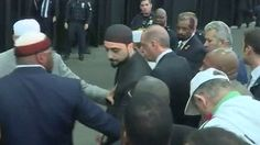 Turkish President Tayyip Erdogan returns home sooner than expected after attending Muslim funeral service for boxing legend Muhammad Ali.