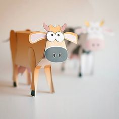 Paper cow with nodding head. www.robives.com/cow #papertoy #paperengineering #fromTheArchives