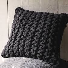 dark gray knitted cushion in interior design magazine - Google Search