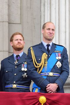 LONDON ENGLAND JULY 10 Prince Harry Duke of Sussex and Prince William Duke of Cambridge watch the RAF 100th anniversary flypast from the balcony of...