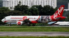 AirAsia (MY) Airbus A320-216 9M-AHG aircraft, painted in ''Ninetology'' special colours Jan. 2014 - Oct. 2016, with the stickers ''Powered by Qualcomm snapdragon'' on the airframe, skating at Malaysia Penang International Airport. 19/07/2015. (Qualcomm=an American multinational telecommunications equipment company). (Qualcomm Snapdragon chips).