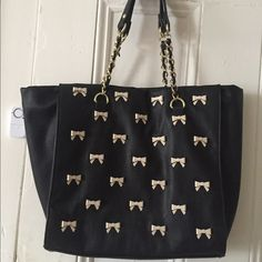 Used Betsy Johnson black bow purse Used Betsy Johnson black purse with cream bows  small scratches shown in picture not noticeable when used *feel free to Make me an offer Betsey Johnson Bags Totes