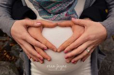 maternity photography - hands shaped like heart on belly
