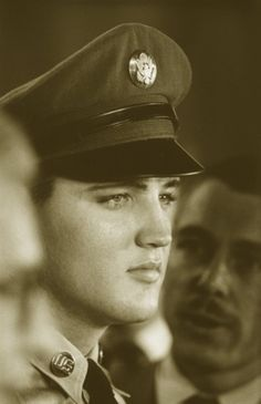 Private Elvis Aaron Presley.@Madison Miller....because you asked what people saw in Elvis, and why 75,000 people have traveled to Memphis for the week of his death.
