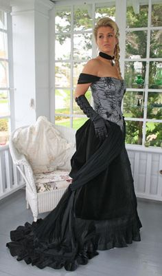 Nice write-up of late Victorian evening-wear. Detailed, off the shoulder, lace and sashes and bustles and beads and fringe....