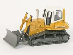 This Liebherr 724 Crawler Diecast Model Tractor is Yellow and features working blade, tracks. It is made by Norscot and is 1:50 scale (approx. 12cm / 4.7in long).  ...