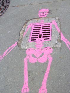 Clever use of grate on the sidewalk -- Skeleton!