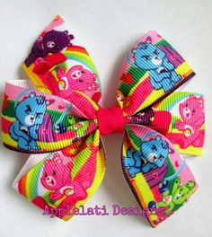 ~This listing is for one small pinwheel hairbow.This bow is made with quality grosgrain ribbon and heat sealed to prevent from fraying. It's attached to a partially lined alligator clip.  ~This bow is perfect to give as party favors,  Easter baskets, stocking stuffer, baby and bridal showers. The...