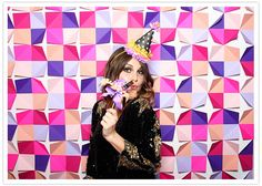 cute and easy idea for photobooth background- looks like origami paper with the corners folded up!
