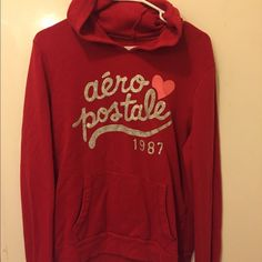 Aeropostale Hoodie Red hoodie with ❤️ on front no stains worn once. Good for the cool summer months sitting by the fire. Aeropostale Tops Sweatshirts & Hoodies