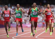 News Photo: Dejen Gebremeskel of Ethiopia leads Bernard Lagat of…