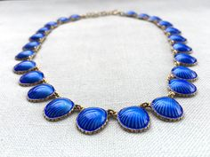 Blue silver enamel necklace, shaped like shells, by Norwegian designer Nils M. Elvik. Read more at the web page: http://solvstempler.no/nils_m_elvik.html