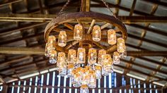 Brilliant Wagon Wheel Chandelier Made with Mason Jars | DIY Joy Projects and Crafts Ideas http://diyjoy.com/mason-jar-crafts-diy-chandelier