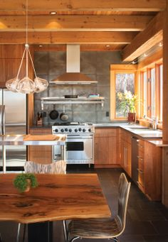 Sustainable home in Colorado. Wood and concrete kitchen by ULLRDesigns. Robert Hawkins architect.