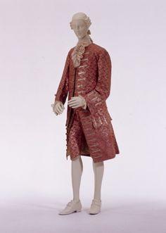 3-piece suit (habit à la française), France, c. 1760-1765. Pink silk (droguet liséré) with a woven silver design of repeating floral and leaf motifs.