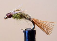 Emerger: Blue-Winged-Olive (BWO) Barr Style Emerger Hook: Scud Hook, sizes 16 to 24 Abdomen: Brown/Olive dubbing Thorax: Gray/Olive Dubbing Tail: Brown Spade Hackle Fibers Wingcase: Dun Hackle Fibe…