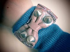 faux leather spiked bow bracelet by So cliché jewelry  https://www.facebook.com/soclichejewelry