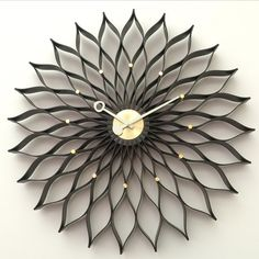 This beautifully crafted George Nelson Sunflower Clock is created by combining and bending plywood into the shape resembling sunflower petals. This clock is crafted with the highest quality materials and a quartz movement, so it will last a lifetime. Each hour is marked with a small metal circle, and the center is black, just like a real sunflower. This impressive piece of art will bring character to any room in your home.