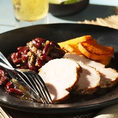 Though Puerto Ricans tend toward fatty cuts of pork with the skin on, lean cuts like pork loin are just as delicious with the intense garlic rub in this recipe. Serve warm with Island Red Beans and rice. Leftover slices make a good sandwich.