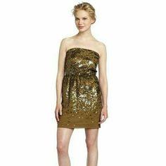 BCBG Bronze Silk & Sequin Mini Dress Atalaya Sequin Strapless Dress Bronze Combo Strapless or optional straps with elasticized waist and fitted skirt. Pockets! Allover scattered sequin detail.  Cutout at back with hook and bar closure.  100% silk shell, 100% polyester contrast and lining. BCBG Dresses