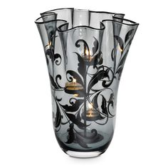 """One of our newest additions to the Forbidden Fruits line. Can you say GORGEOUS? ... Forbidden Romance Hurricane: Ruffled and romantic! Dramatic mouth-blown glass is as feminine as lace. Includes Silver-tone Universal Tealight Tree for use with tealights; also holds jars and pillars. All candles sold separately. 11¾""""h."""