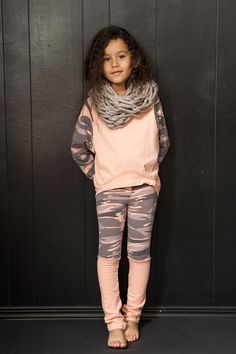 Soft and stretchy leggings with Camoflage print and attached leg warmers. Preshrunk. Made in the beautiful USA.
