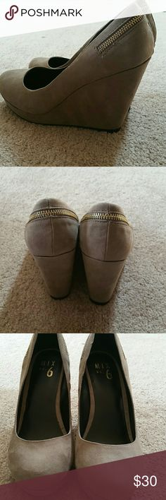 NEVER WORN taupe suede wedges Really cute wedges that I've never worn because they are a little too small for me. Can be worn casual with jeans or more dressed up for a night out! Shoes Wedges