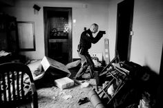 Anthony Suau - Detective Robert Cole sheriff Cleveland weapon armed abandoned vacant home eviction mortgage foreclosure mess (World Press Photo Rosa Parks, Time Magazine, Illinois, Einstein, World Press Photo, Military Coup, Photo Awards, Photojournalism, Photo Contest