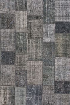 These hand-knotted patchwork rugs are a mix of over-dyed and distressed vintage rugs. Flat-woven rugs are unique due to their method of construction. Unlike knotted wool rugs, flat-woven rugs are made on a loom. They are thin with a very low pile, making them ideal for an entryway where door clearance is an issue. However, they are extremely durable and many are reversible for extended life and beauty.