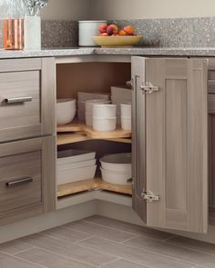 Another creative way to use the corner space of your kitchen cabinetry is with a lazy Susan. Easily spin it around to retrieve dinnerware and serveware. Discover additional creative ways to organize your kitchen with this video from Martha.