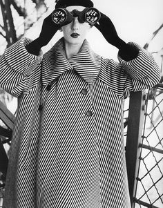 Dovima, coat by Balenciaga, photo by Avedon, Eiffel Tower, Paris, August 1950    From the book: Avedon Fashion 1944-2000
