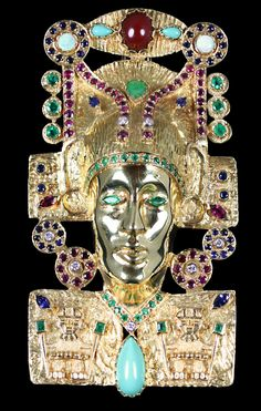 Ancient Mesoamerican Jewel Encrusted Gold Brooch. Can also be worn as a large pendant. Accompanied by Rubies, Turquoise, Opals, Emeralds, Sapphires, Diamonds, Jade, and Red Coral. Set in 18 karat Yellow Gold.