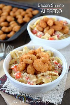 Easy homemade Alfredo sauce that can be made in minutes. Bacon, red peppers, and popcorn shrimp make this pasta taste amazing!